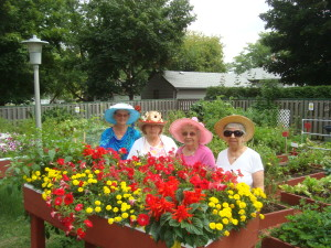 four women and flower garden