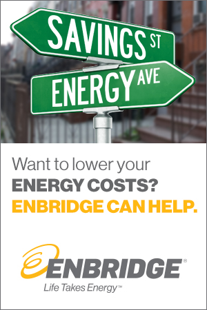 Street signs that read Savings street and energy ave. Want to lower your energy costs? Enbrdige can help. Enbridge logo. Life takes energy