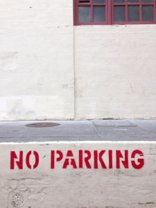 No Parking Sign on concrete