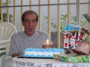Man with birthday cake and candle