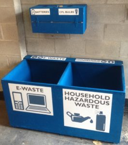 "Collection bins reading ""e-waste"" and ""household hazardous waste"""