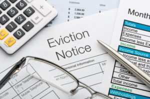 Close up of eviction notice with calculator and pen