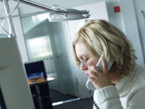 Stressed woman at work, on the phone