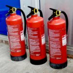 Three red fire extinguishers