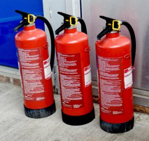 Three red fire extinguishers