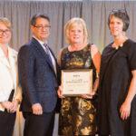 Darlene Cook accepting award on the ONPHA conference