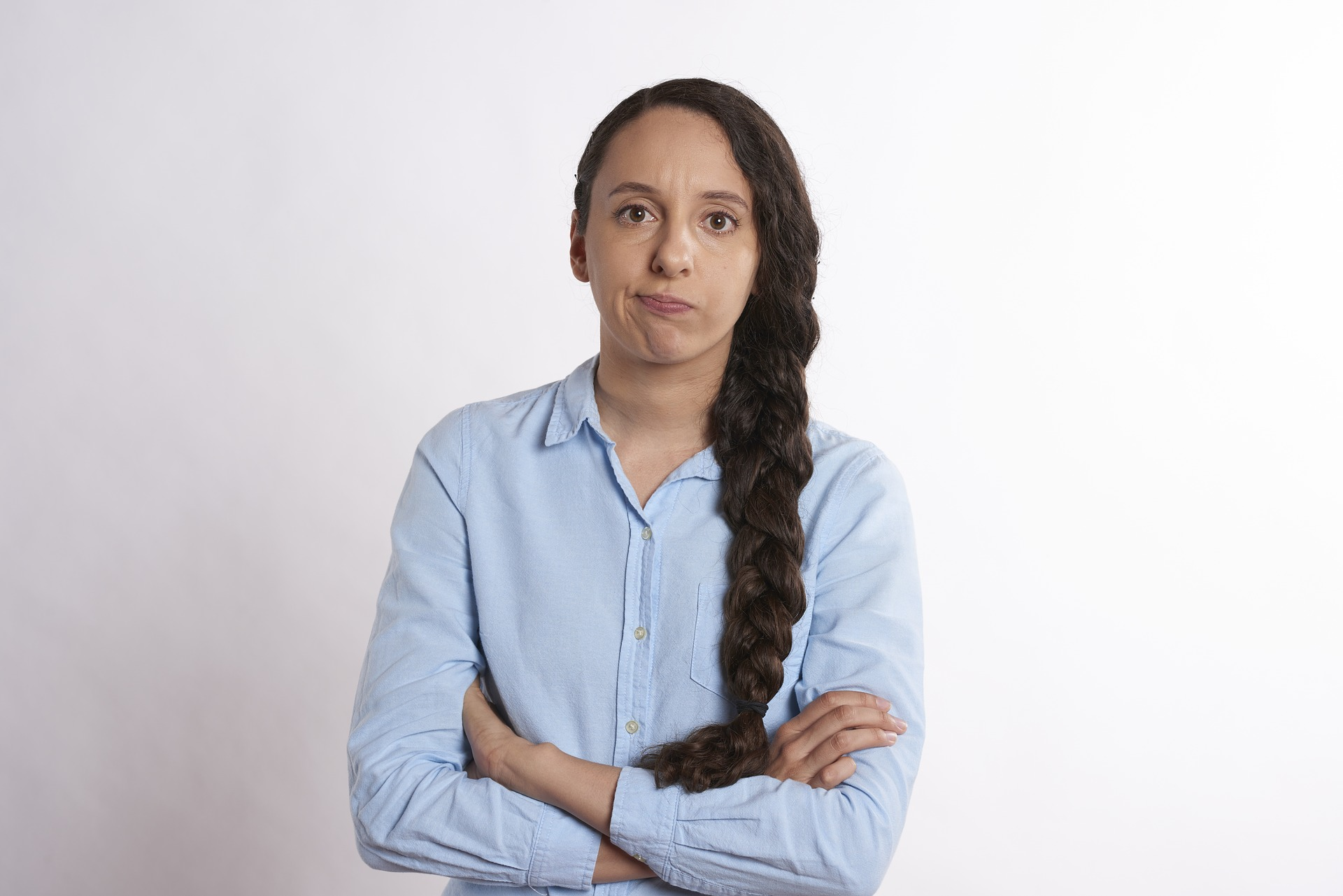 Woman looking frustrated with crossed arms