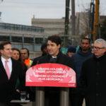 Justin Trudeau speaking at podium in Toronto