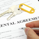Close up of hand singing rental agreement