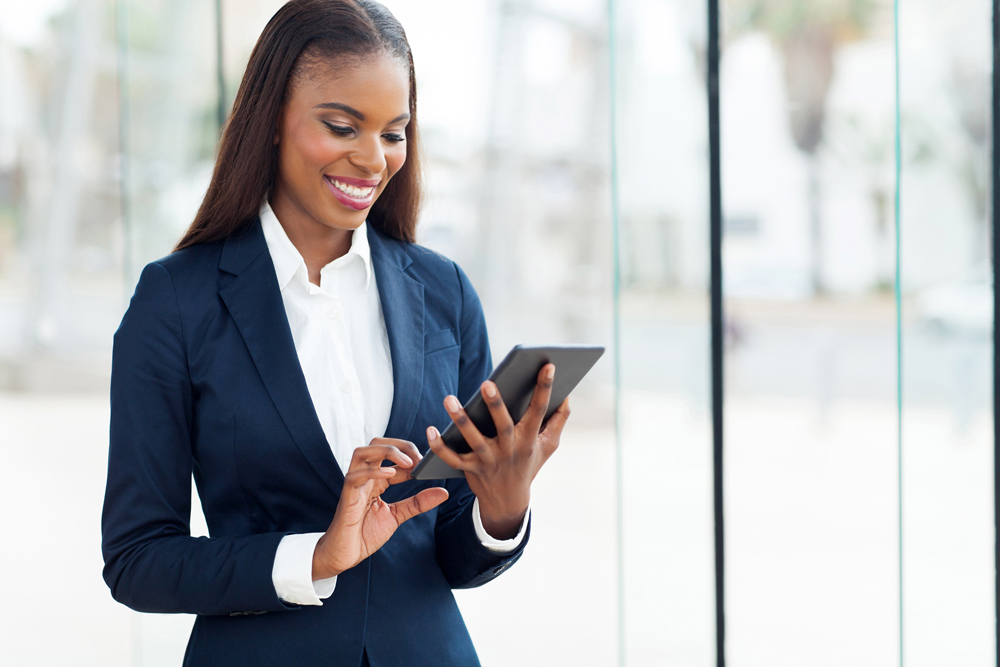 Woman in a business suit holding an ipad