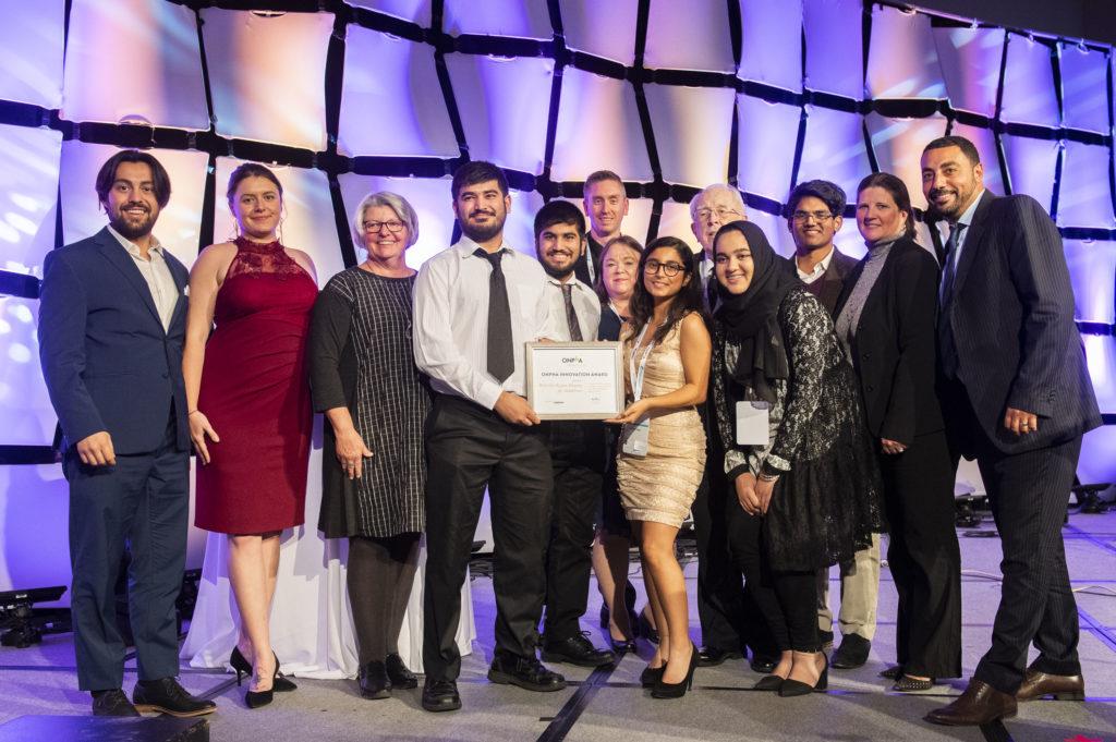 2019 ONPHA Innovation Award winners Waterloo Region Housing pose with their award.