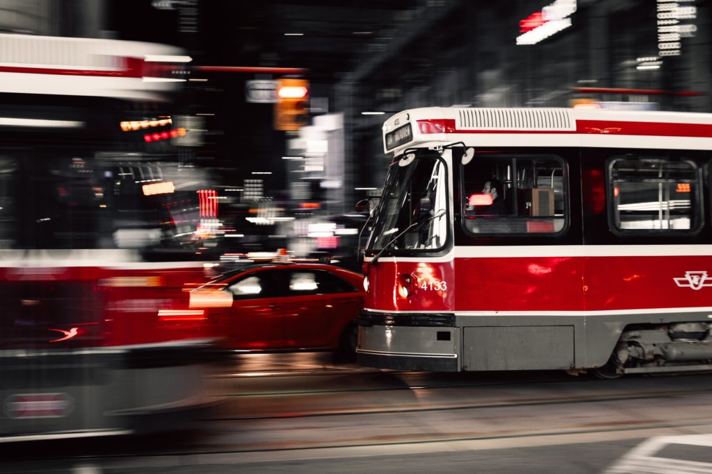 Toronto streetcars pass each other at night in the city's downtown core