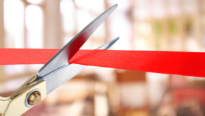 Scissors cutting a ribbon