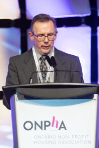 Steve Garrison accepts his Sybil Frenette Award for Outstanding Leadership at the 2019 ONPHA Conference