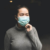 A woman wearing a medical mask