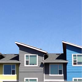 A row of brightly-coloured townhomes